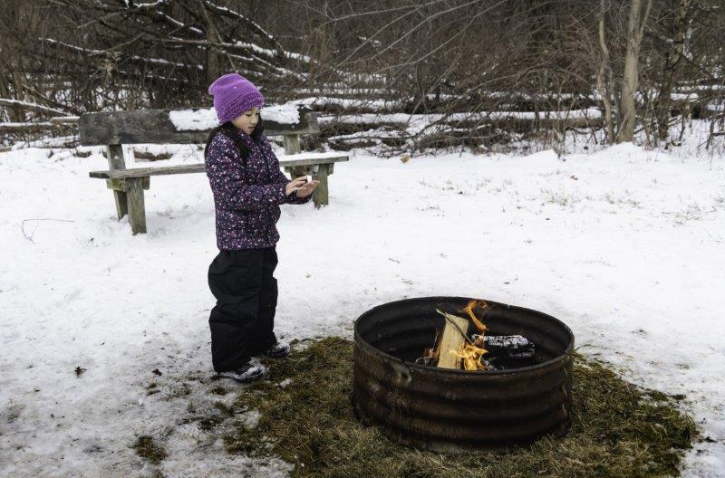 fire pit near the sledding hill at Bloomer Park
