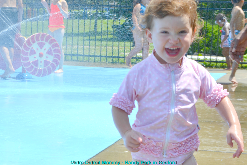 Carlyn enjoying the spray park in Redford