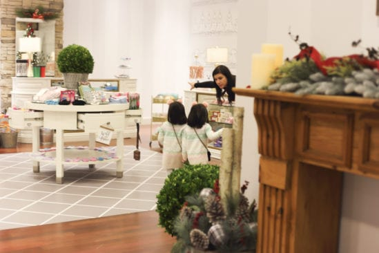 Young children are helped navigate through the shop to pick out 3 items of their choice.