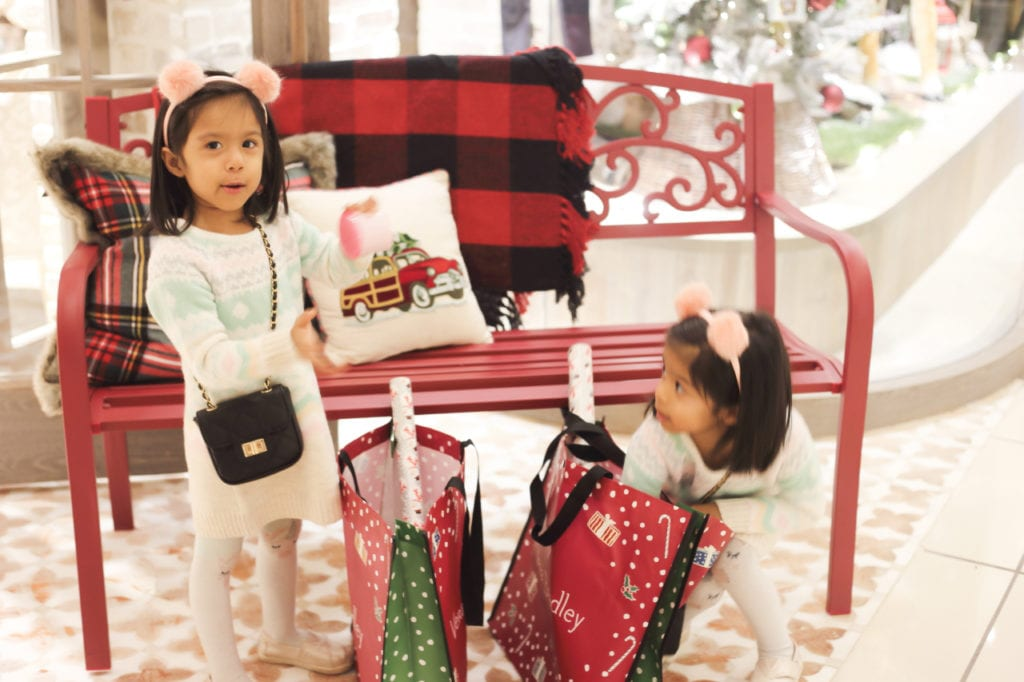 Kids are given some wrapping paper in their shopping bags to wrap their Holiday presents at home!