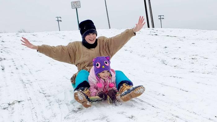 The girls enjoy sledding in Metro Detroit
