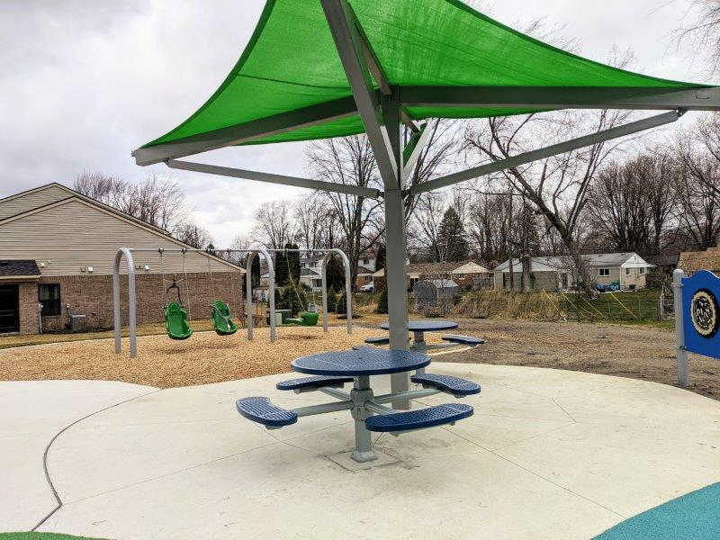 picnic tables and swings
